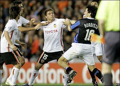Inter's Nicolas Burdisso under attack from Valencia's Sanchez