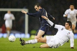 Andrea Barzagli stops James McFadden with a sliding tackle; the Palermo defender was one of the best players of the game Saturday