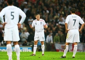 Stevie's gee-up: Gerrard calls on Gareth Barry (right) and Joleon Lescott for more