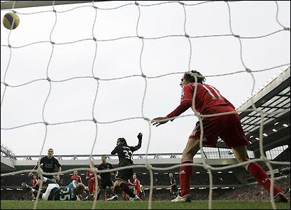 Carlitos Tevez turns in Wayne Rooney's shot just before half time.