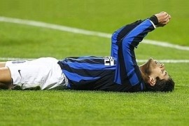 Julio Cruz lies on the San Siro grass in desperation: Inter are out of the Champions League