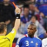 Slovak referee Michel L'ubos (L) hands a red card to French defender Eric Abidal (C) next to midfielder teammate Claude Makelele (R) during the Euro 2008 Championships Group C football match France vs. Italy on June 17, 2008 at the Letzigrund stadium in Zurich. (AFP/Getty Images)