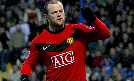 Wayne Rooney celebrates on his way to a hat-trick in Manchester United's win at Portsmouth