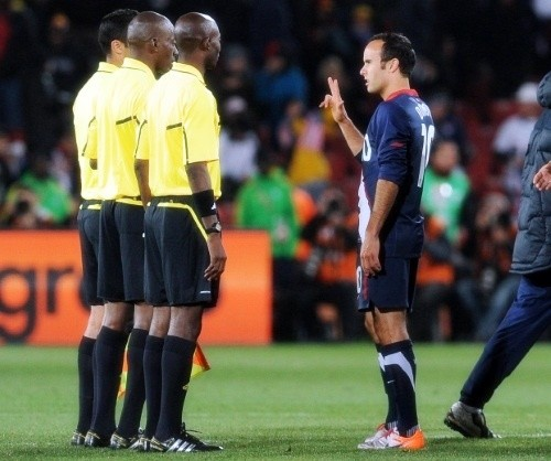 Landon Donovan with the match officials after the game at Ellis Park