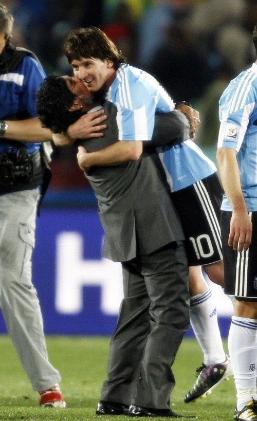 The ultimate hands-on manager: Diego Maradona celebrates with Leo Messi
