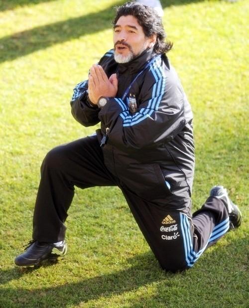 Diego Maradona praying that God is not Brazilian