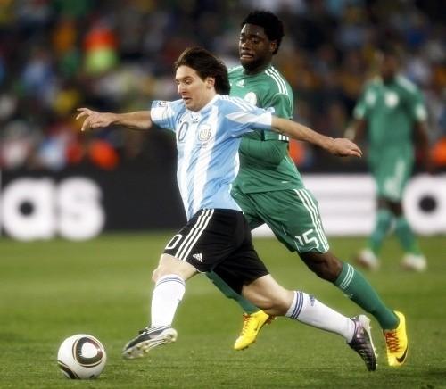 Leo Messi takes on Haruna Lukman