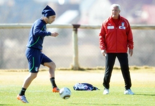 Andrea Pirlo under the watchful eye of Marcello Lippi. Could Pirlo provide the missing link from the bench?