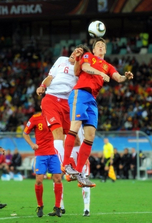 Fernando Torres in action against Benjamin Huggel of Switzerland