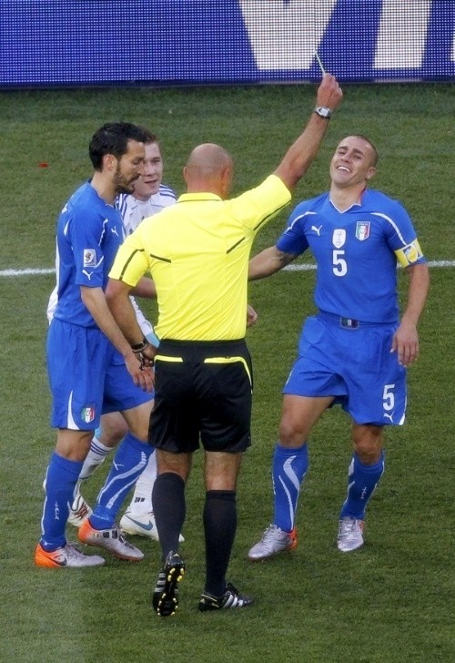 Fabio Cannavaro plays his last game for Italy. Here is shown a yellow card by Howard Webb.