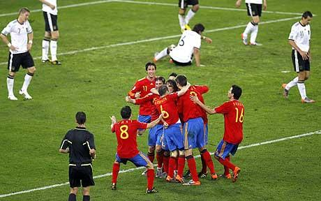The Spanish team celebrate after Puyols headed goal.