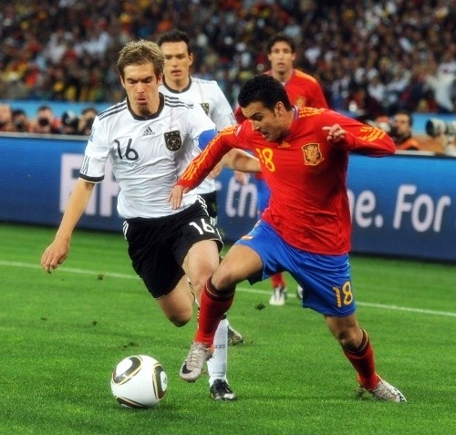 Pedro and German skipper, Phillipe Lahm. Pedro made the history books by scoring in his 7th competition over the last season
