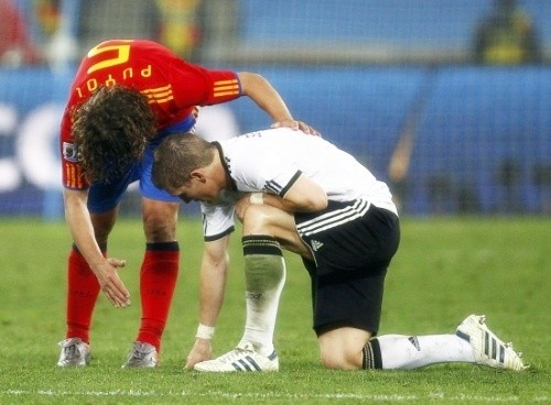 Carles Puyol was a gracious winner and consoled Bastian Schweinsteiger
