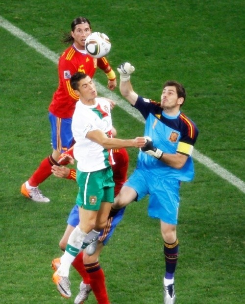 Cristiano Ronaldo challenging for a ball against his Real Madrid teammate, Iker Casillas