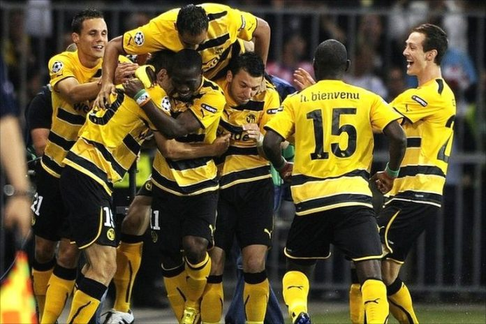 Young Boys celebrate their first half lead against Tottenham Hotspur