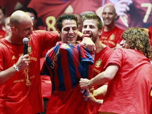 Fabregas is forced to don a Barca shirt