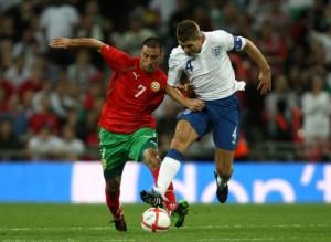 Steven Gerrard and Ivelin Popov