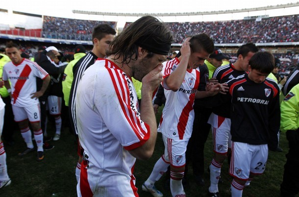 River Plate's Pavone reacts next to teammates at the end of their Argentine First Division playoff soccer match against Belgrano in Buenos Aires