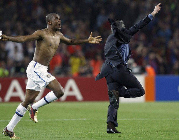 Inter Milan's Eto'o celebrates next to coach Mourinho after their Champions League semi-final second leg soccer match against Barcelona at the Nou Camp stadium in Barcelona
