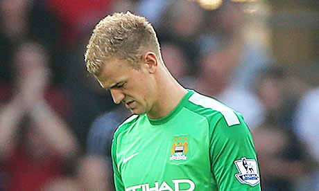 Manchester City's Joe Hart walks off the pitch dejected after the 3-2 defeat at Cardiff City Stadium