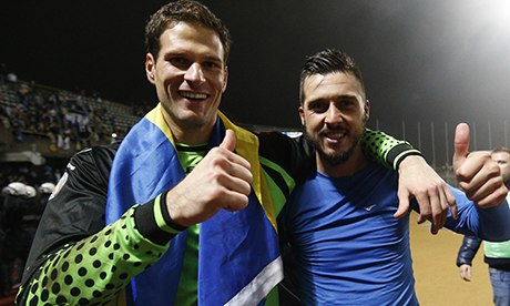Bosnia's Asmir Begovic, left, and Haris Medunjanin celebrate their victory over Lithuania