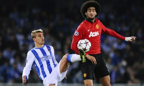 Marouanne Fellaini of Manchester United disputes possession with Real Sociedad's Antoine Griezmann.