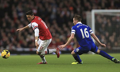 Arsenal's Mesut Ozil and Everton's James McCarthy