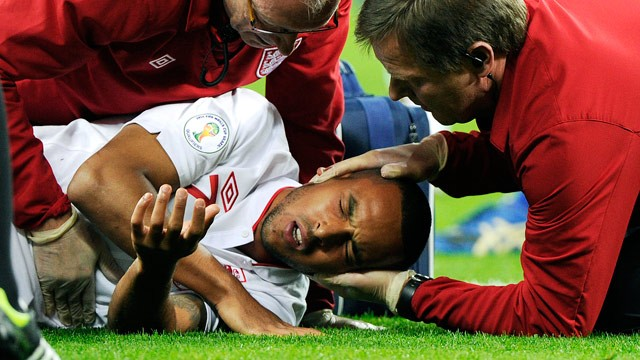 Theo Walcott being treated by England medics