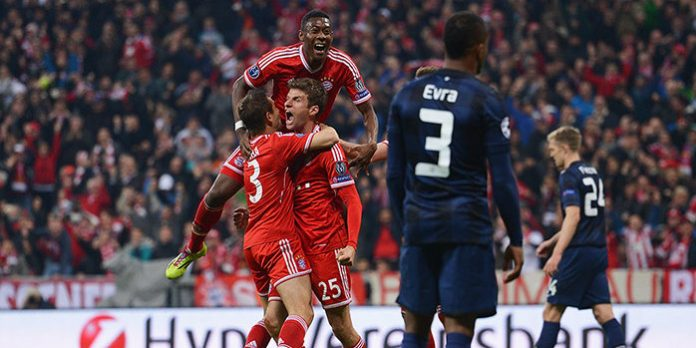 Thomas Mueller of Bayern Muenchen celebrates scoring his team's