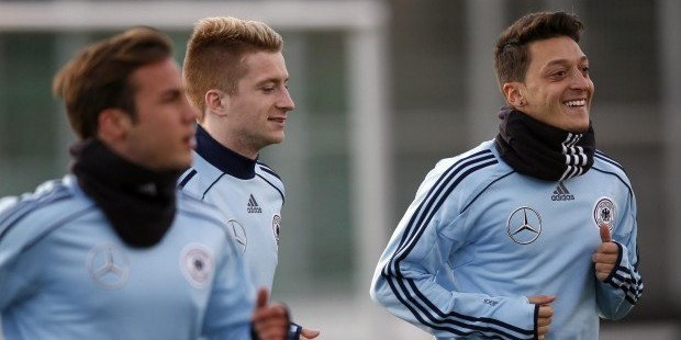 Germany-s-Gotze-Reus-and-Ozil-attend-a-training-session-ahead-of-their-2014-Wor