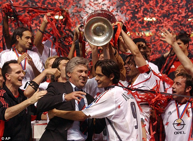 Ancelotti hugs Filippo Inzaghi as he win his first managerial Champions League