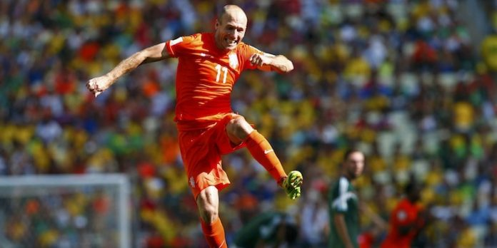 Arjen Robben of the Netherlands celebrates after winning their 2014 World Cup round of 16 game against Mexico at the Castelao arena in Fortaleza