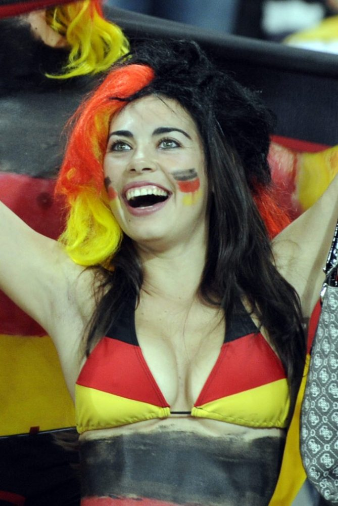 germany fans with world cup german flag tattoo on face-f23806