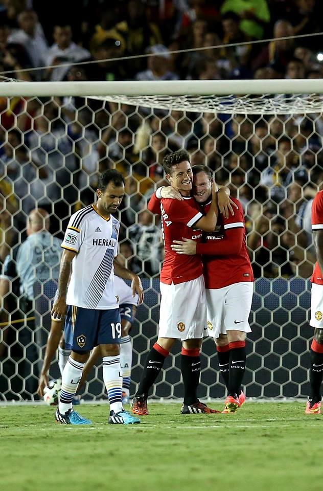 Herrera congratulates Rooney for his brace.