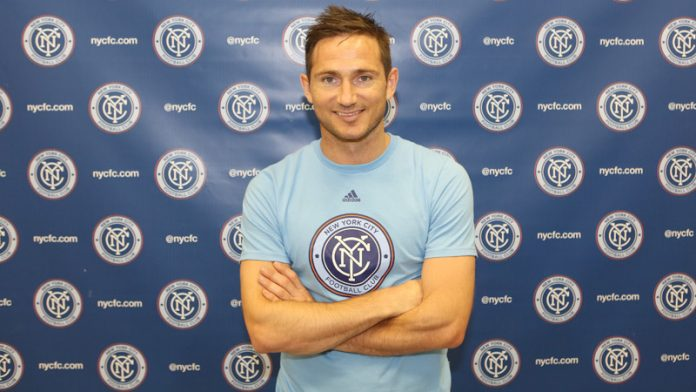 Frank Lampard posses while wearing a t-shirt of his new teams logo. Photo provided by MLSSoccer.com