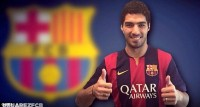 Suarez completed his move to Barcelona