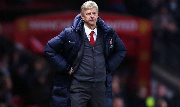 Arsene Wenger hits back on owners