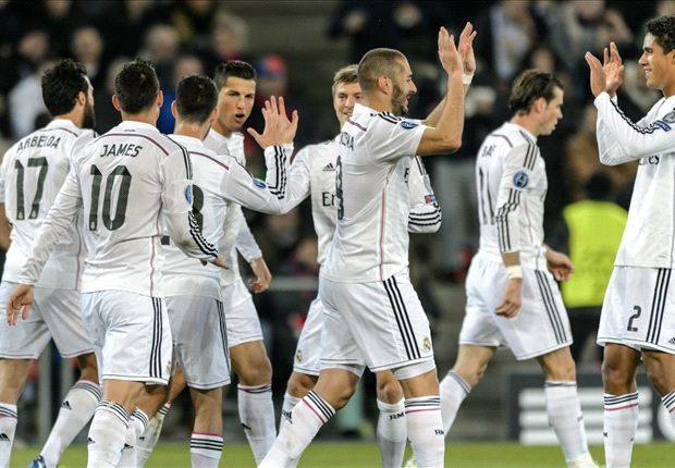 Real Madrid secured top spot in Group B with a win at Basel.