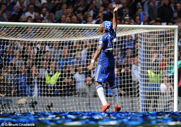 28466B8F00000578-3066204-Chelsea_legend_Didier_Drogba_dances_on_the_Stamford_Bridge_pitch-a-44_1430666205273