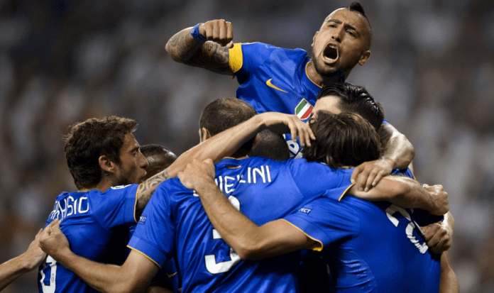 Vidal jumps the highest as Juventus celebrates Morata's crucial goal.