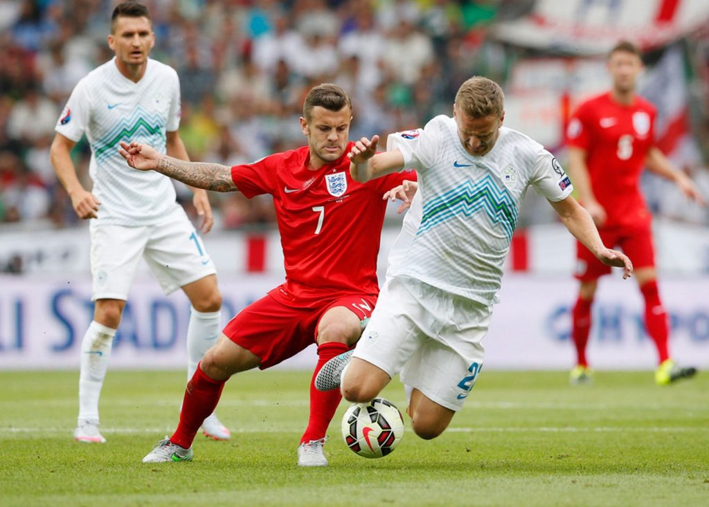 Wilshere in action with Slovenia's Ales Mertelj. The little Arsenal midfielder's tenacity in the tackle sets him apart from most other playmakers.