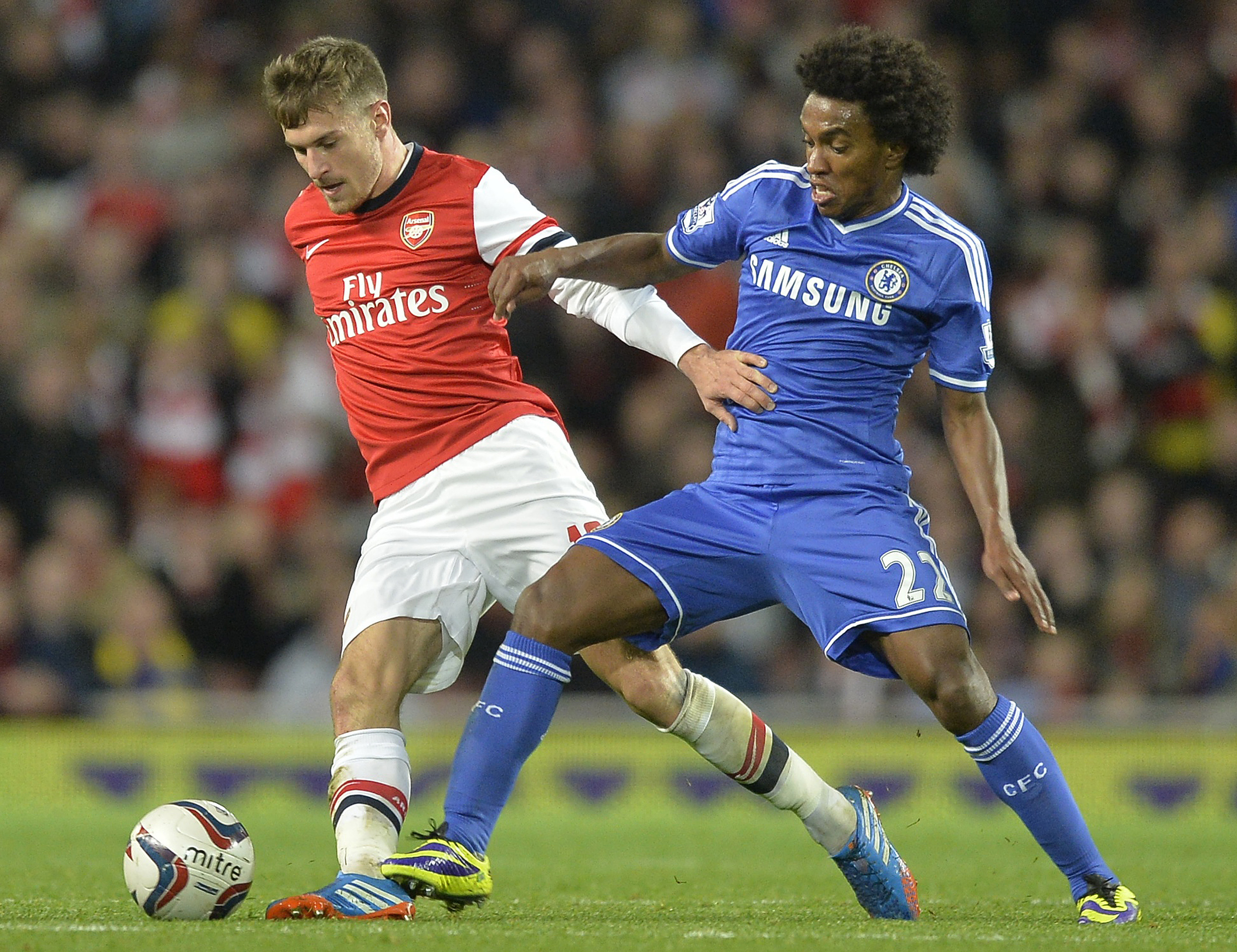 Arsenal's Ramsey challenges Chelsea's Willian during their English League Cup fourth round soccer match at Emirates Stadium in London