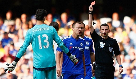Michael Oliver shows Courtois a red card for denying Gomis a clear goalscoring opportunity