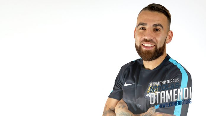 Nicolas Otamendi of Valencia signs for Manchester City
