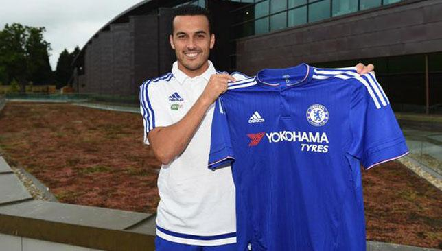 Pedro poses with a Chelsea shirt after his medical yesterday