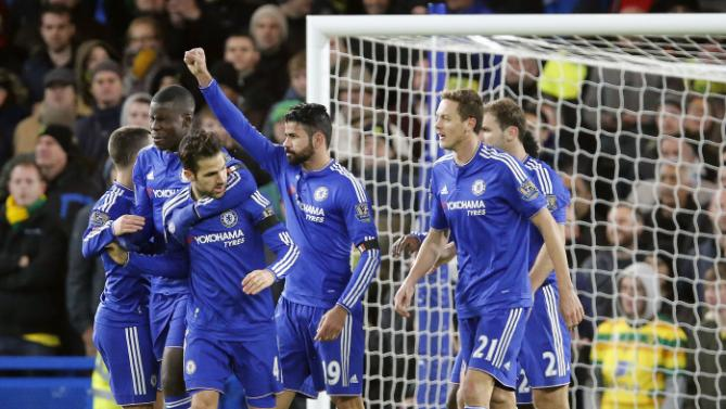 Chelsea's Diego Costa, center, celebrates with teammates after scoring  during the English Premier League soccer match between Chelsea and Norwich City at Stamford Bridge stadium in London, Saturday, Nov. 21, 2015. (AP Photo/Frank Augstein)