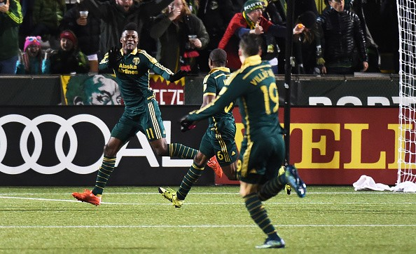 PORTLAND, OR - NOVEMBER 22: Dairon Asprilla #11 of Portland Timbers celebrates with his teammates after scoring a goal during the second half of the match against the FC Dallas at Providence Park on November 22, 2015 in Portland, Oregon. (Photo by Steve Dykes/Getty Images)