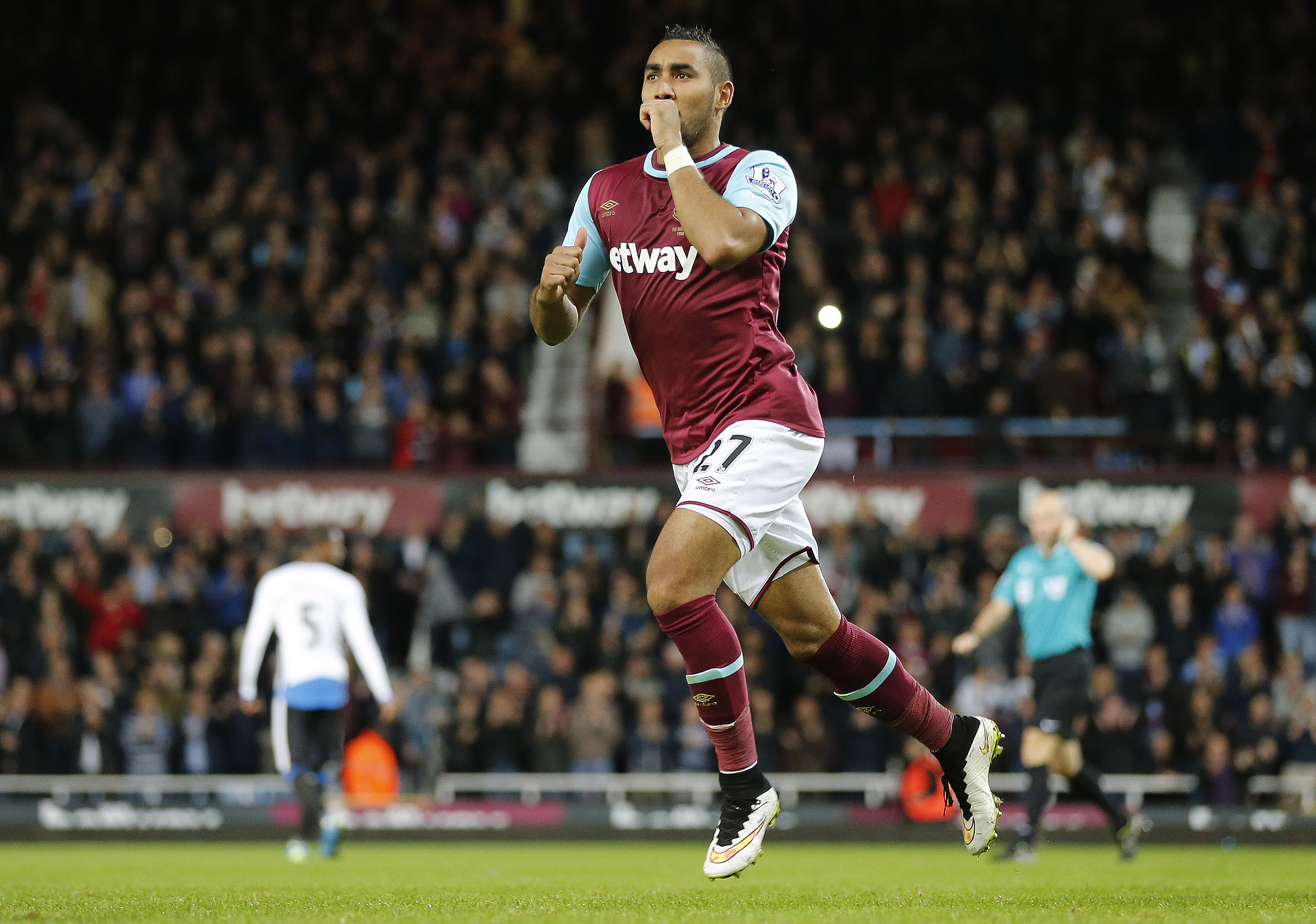 West Ham's Dimitri Payet celebrates after scoring during the English Premier League soccer match between West Ham and Newcastle at Boleyn Ground in London, Monday, Sept. 14, 2015.(AP Photo/Frank Augstein)