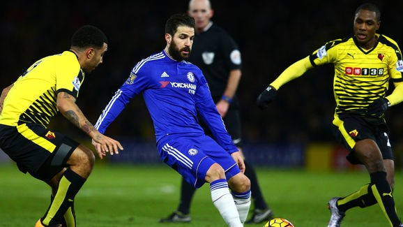 WATFORD, ENGLAND - FEBRUARY 03: Cesc Fabregas of Chelsea passes as Troy Deeney of Watford and Odion Ighalo of Watford close in during the Barclays Premier League match between Watford and Chelsea at Vicarage Road on February 3, 2016 in Watford, England. (Photo by Clive Mason/Getty Images)
