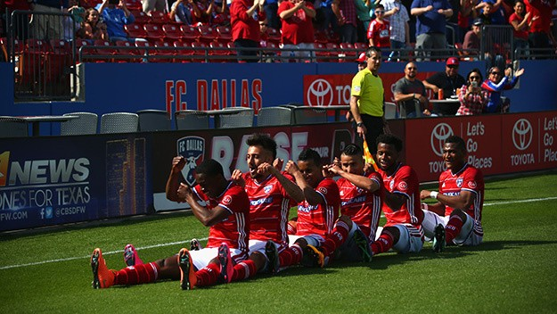 FRISCO, TX - MARCH 06: Fabian Castillo #11 of FC Dallas, front celebrates his goal with the team against the Philadelphia Union in the first half during the MLS opening game at Toyota Stadium on March 6, 2016 in Frisco, Texas. (Photo by Ronald Martinez/Getty Images)
